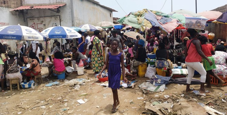DANIEL GARELO PENSADOR: A young girl walks through the Buracos market, in the Angolan restive region of Cabinda, on April 9, 2019 in Cabinda, Angola. - Since he came to power in 2017, Angolan President Joao Lourenco has promoted himself as transparent, moderate leader who is kee