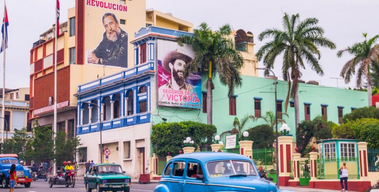 julianpetersphotography: Santiago de Cuba, Cuba - January 4, 2016: Santiago de Cuba is often referred to as birthplace of the Cuban revolucion. Posters of Fidel Castro advertise the revolution